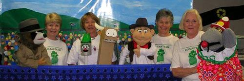 Volunteers helping at puppet show